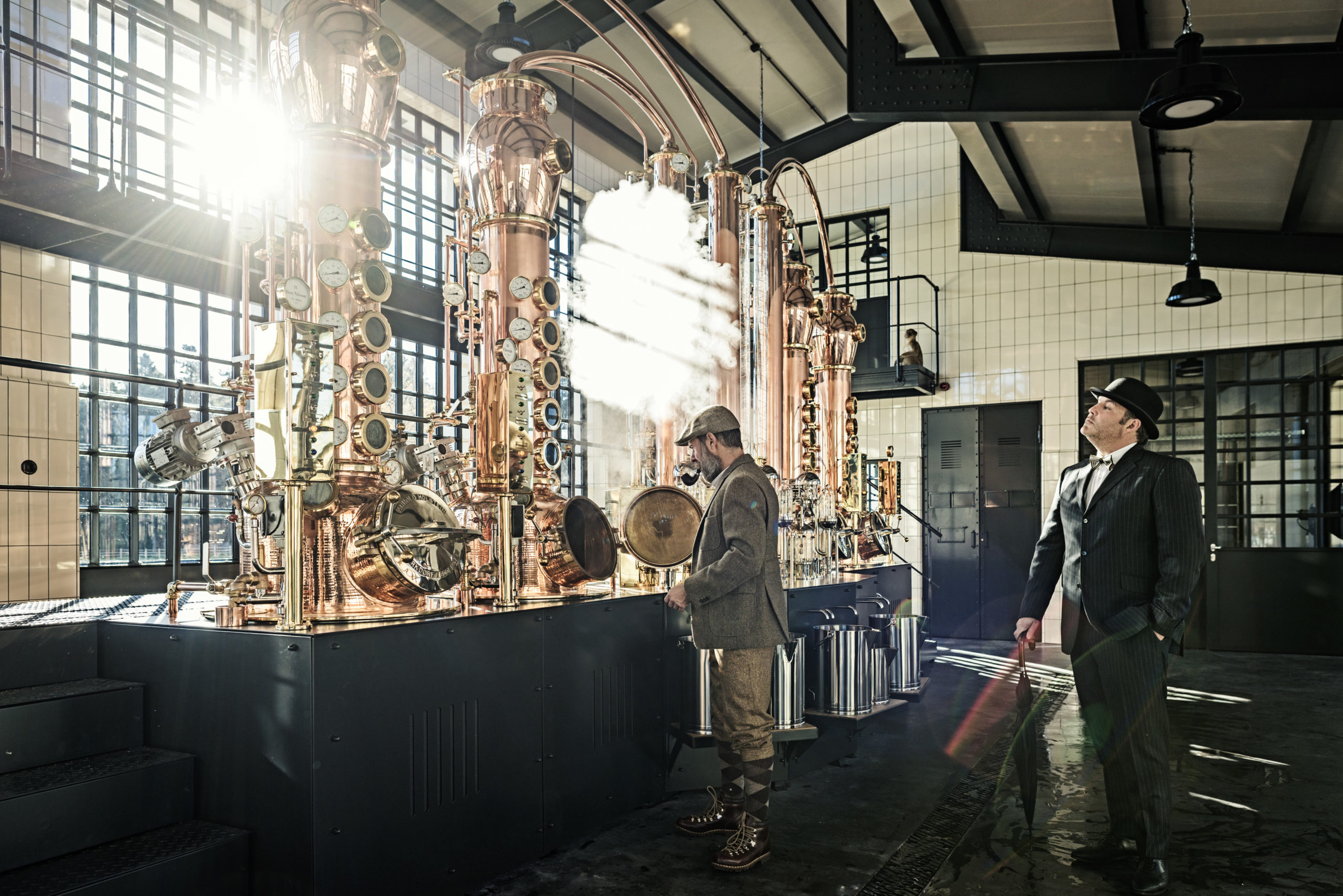 Man with Pipe in Gin Factory and Man overlooking the machines
