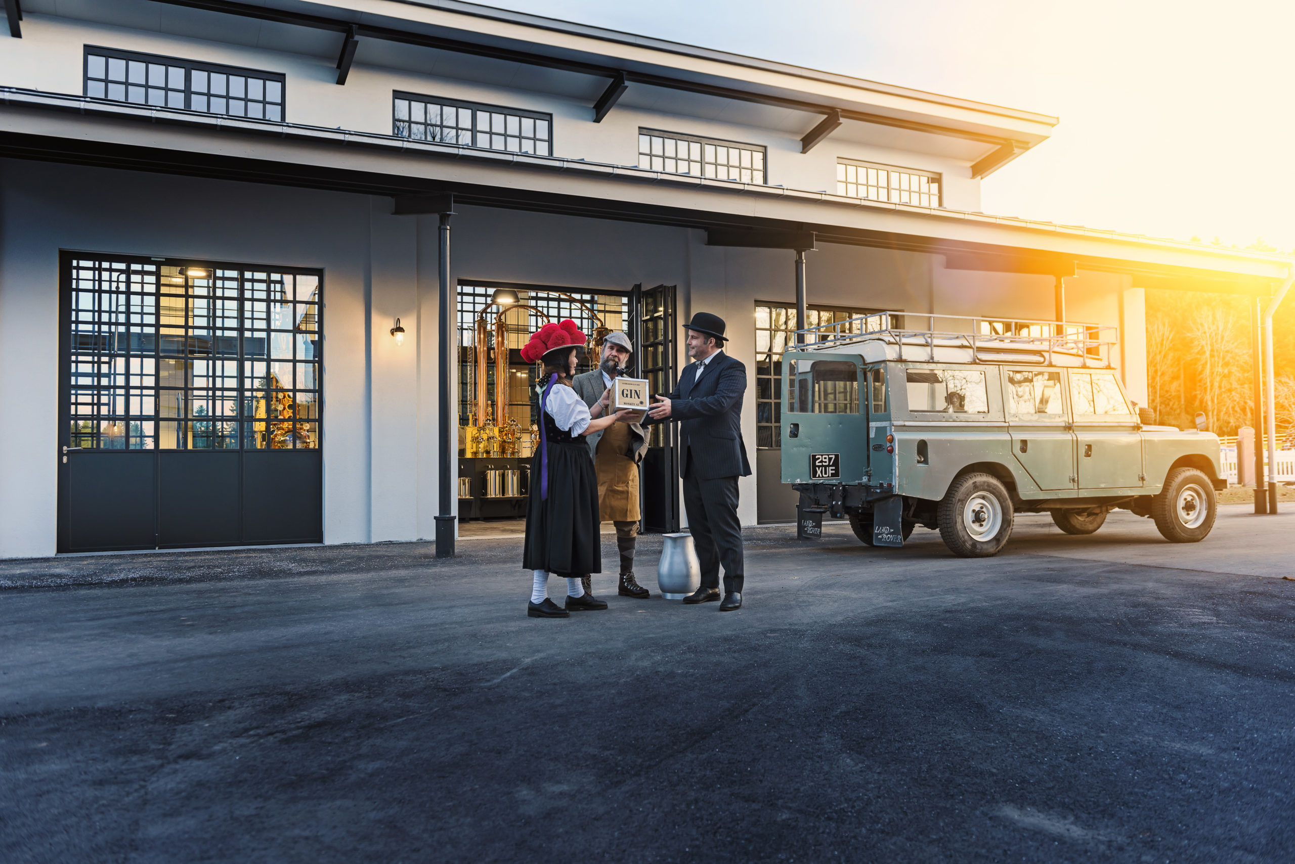 Monkey 47 Gin Case with couple and Jeep outside of factory